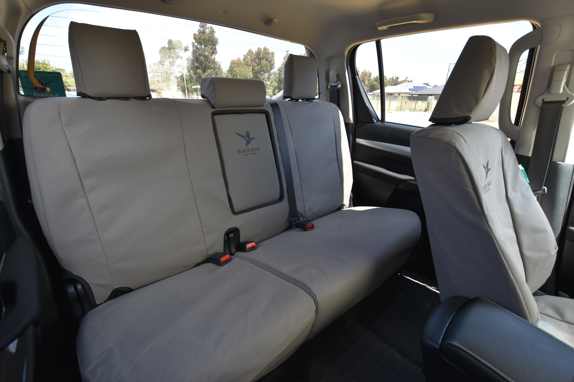 Image shows rear bench seat with 60/40 split base  and fold down armrest in Grey Canvas.